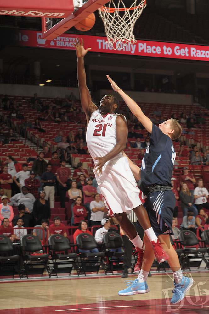 NWA Democrat-Gazette/ANDY SHUPE<br /> Manuale Watkins (left) of Arkansas scores past Nick Shoemaker of Southwestern Oklahoma State Thursday, Nov. 5, 2015, during the second half in Bud Walton Arena. Visit nwadg.com/photos to see more photographs from the game.