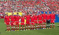02 June 2013: The Canadian Women's National Team participates in the national anthems and opening ceremonies during an International Friendly soccer match between the U.S. Women's National Soccer Team and the Canadian Women's National Soccer Team at BMO Field in Toronto, Ontario.<br /> The U.S. Women's National Team Won 3-0.