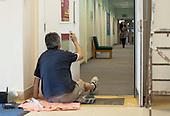 Decorator working in the school corridor, state secondary school.