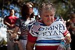 A supporter of Republican vice presidential candidate Rep. Paul Ryan leaves a campaign rally in Ocala, Florida, October 18, 2012.