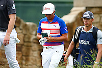 Rickie Fowler walks to the the 9th tee during the 2016 U.S. Open in Oakmont, Pennsylvania on June 16, 2016. (Photo by Jared Wickerham / DKPS)