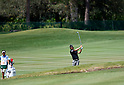 (L-R) Hiroyuki Kato, Ryo Ishikawa (JPN),.MARCH 23, 2012 - Golf :.Ryo Ishikawa of Japan shoots a ball on the 5th hole as his caddie looks on during the second round of the Arnold Palmer Invitational at Arnold Palmer's Bay Hill Club and Lodge in Orlando, Florida. (Photo by Thomas Anderson/AFLO)(JAPANESE NEWSPAPER OUT)