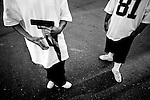 Canoga Park Alabama gang members flash a gun and a CPA sign in the northern parking lot of Lanark Park. Police identify CPA members in part by their dress, which can include white tennis shoes, baggy pants or shorts with long socks and oversized white, blue or black T-shirts. CPA gang members also shave their heads, wear black sunglasses and carry blue bandanas. A gang injunction outlining a 4.65-square mile area of the city prohibits known gang members from associating with other members, drinking alcohol in public, intimidating witnesses and being out from 10 p.m. to sunrise, among other off-limits behavior.