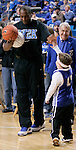 "Former Wildcat Jack ""Goose"" Givens highfives a young Kentucky fan during ESPN College Game Day at Rupp Arena on Saturday. Photo by Zach Brake 