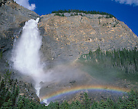 Yoho National Park, B.C., Canada:  Rainbow created in the spray from Takakkaw Falls plunging 380m into the Yoho River Vallley in the Canadian Rockies