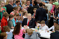 United States President Donald Trump makes cards for members of the military at the annual Easter Egg roll on the South Lawn of the White House in Washington, DC, on April 17, 2017. <br /> CAP/MPI/CNP/RS<br /> &copy;RS/CNP/MPI/Capital Pictures