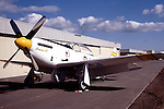 "Legendary pilot Bob Love's P-51 Mustang ""Bernie's Bo"" sits in front of the hangar ready for flight. Bob was an instructor pilot in the P-38 lightning during the World War II and became an ace in the Korean War flying the F-86 Sabre. Bob also participated regularly at the Reno Air Races each September. Bob passed away in the fall of 1986 and his Mustang since been owned by Russ Francis, Bill Dause, and is now owned by Dream Machines LLC."
