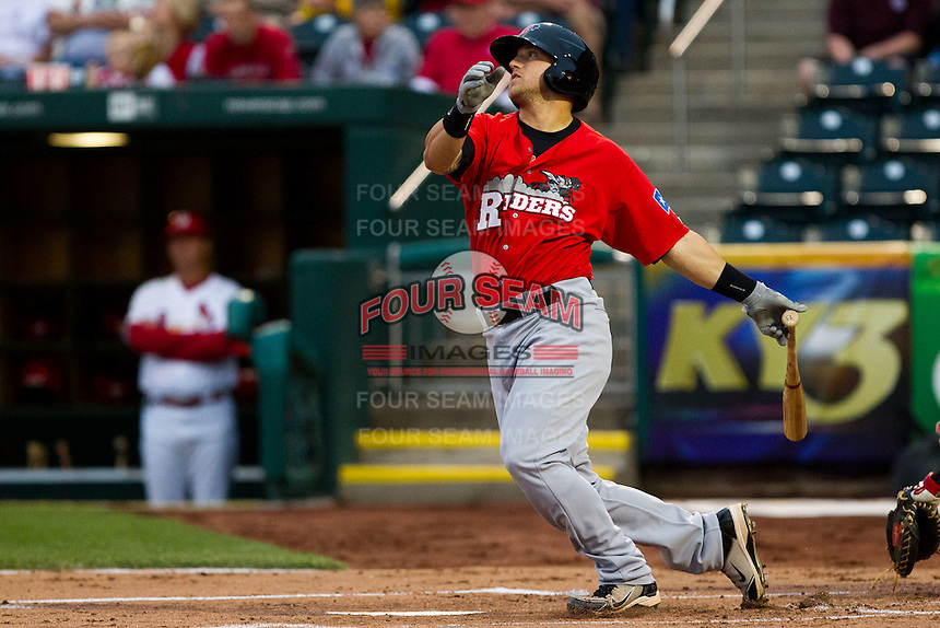 Michael Bianucci (33) of the Frisco RoughRiders watches his hit go into the outfield during a game against the Springfield Cardinals on April 14, 2011 at Hammons Field in Springfield, Missouri.  Photo By David Welker/Four Seam Images.