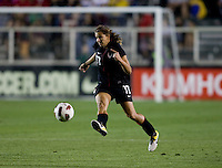 Tobin Heath (17) of the USWNT passes the ball forward during the game at WakeMed Soccer Park in Cary, NC.   The USWNT defeated Japan, 2-0..