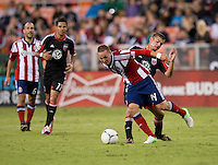Perry Kitchen (13) of D.C. United tries to take the ball away from Casey Townsend (14) of Chivas USA during the game at RFK Stadium in Washington, DC.  D.C. United defeated Chivas USA, 1-0.
