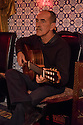 Lisbon, Portugal. 26.03.2015. Francisco, a Fado guitarist, in a restaurant in Alfama, Lisbon, Portugal. © Jane Hobson.