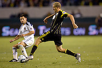 Columbus Crew forward Steven Lenhart moves past LA Galaxy midfielder Dema Kovalenko. The LA Galaxy defeated the Columbus Crew 3-1 at Home Depot Center stadium in Carson, California on Saturday Sept 11, 2010.