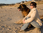 Scenes of Leonberger dog enjoying Cannon Beach, Oregon