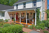 Annual garden of mixed flowers marigolds, Dusty miller, bidens, zinnias, celosia, dahlia, house porch for sense of sunny style