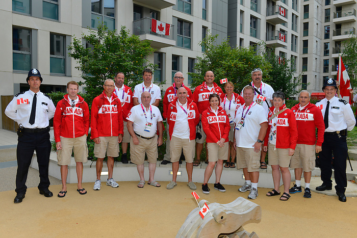 LONDON, ENGLAND 26/08/2012 - Coaches for Team Canada's Paralympic competitors pose for a group photo during a pep rally at Canada House at the London 2012 Paralympic Games. (Photo: Phillip MacCallum/Canadian Paralympic Committee)