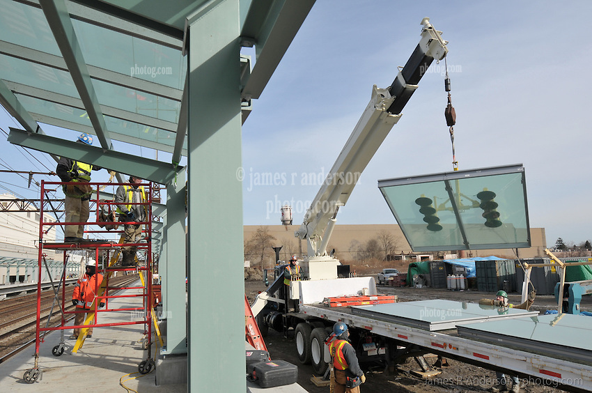 Installing Platform Canopy Glass. Fairfield Metro Commuter Rail Station, Fairfield, CT on 19th site visit of monthly chronological documentation.