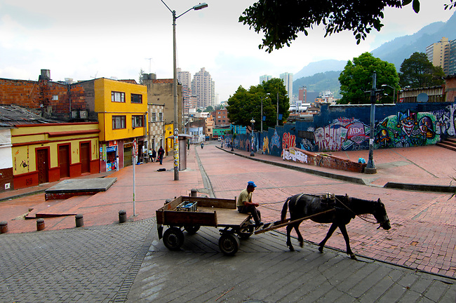 Horse drawn wagon through the streets of Bogota, Colombia.