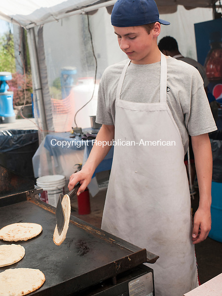 WATERBURY, CT-8 May 2015-050815EC05-  Daniel Minchella flips pitas iduring a busy assembly line of gyro making. Friday marked the opening day of Waterbury's 43rd Annual Greek Festival. Holy Trinity Greek Orthodox Church along Chase Parkway hosts the event, which includes food, music, jewelry, and other traditional items. The festival runs through Sunday. Erin Covey Republican-American