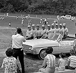 Bethel Park PA:  Members of the BBA posing next to a car during the annual parade for the Bethel Baseball Association - 1964.  The BBA was very successful in teaching the young boys how to play baseball the right way.  The proof was that Bethel Park High School Baseball teams were some of the most successful in WPIAL history. Photo taken at the Bethel Park High School baseball field before the annual drawing of a new buick.