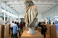 "Patrons view sculptures, including this ""Berenice"" by an unknown Italian artist in the 1600s, during the pubic opening of Louvre Atlanta at the High Museum of Art. Over the next three years, the High Museum will feature hundreds of works of art from the Musée du Louvre in Paris."