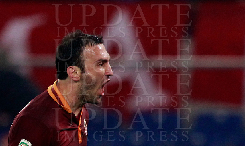 Calcio, Serie A: Roma vs Udinese. Roma, stadio Olimpico, 17 marzo 2014.<br /> AS Roma defender Vasilis Torosidis, of Greece, celebrates after scoring during the Italian Serie A football match between AS Roma and Udinese at Rome's Olympic stadium, 17 March 2014.<br /> UPDATE IMAGES PRESS/Isabella Bonotto