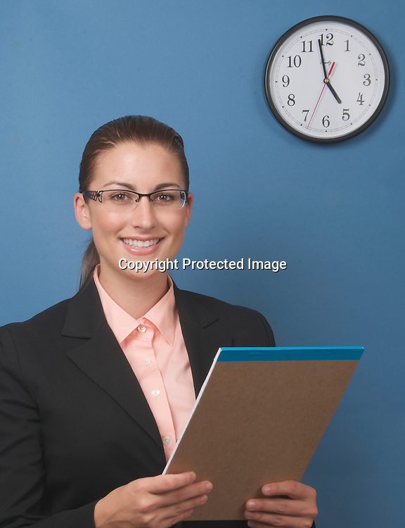 Woman working with clock