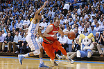 26 January 2015: Syracuse's Trevor Cooney (10) and North Carolina's Marcus Paige (left). The University of North Carolina Tar Heels played the Syracuse University Orange in an NCAA Division I Men's basketball game at the Dean E. Smith Center in Chapel Hill, North Carolina. UNC won the game 93-83.