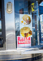 """A sign advertising """"help wanted"""" is seen in the window of a diner in the Woodside neighborhood of Queens in New York on Tuesday, June 14, 2016. (© Richard B. Levine)"""