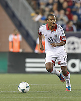 D.C. United defender Ethan White (15) brings the ball forward.  In a Major League Soccer (MLS) match, the New England Revolution (blue) tied D.C. United (white), 0-0, at Gillette Stadium on June 8, 2013.