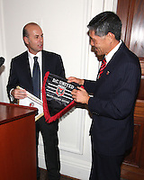 Umberto Gandini of AC Miland and Will Chang of DC United exchange pennants at a reception for AC Milan at DAR Constitution Hall in Washington DC on May 24 2010.