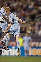 Colorado Rapids midfielder Jeff Larentowicz (4) heads the ball. The Colorado Rapids defeated the New England Revolution, 2-1, at Gillette Stadium on April 24, 2010.