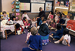 San Francisco CA 1st grade class having a meeting with their teacher looking on