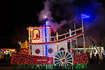 "The ""Daisy Belle"" float creates steam as it makes its way down the street for the Los Altos Festival of Lights Parade."
