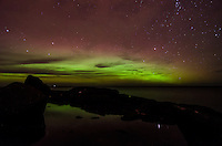 A view of the Northern Lights, through the clouds, over Lake Superior. Taken at the Black Rocks of Presque Isle Park. Marquette, MI