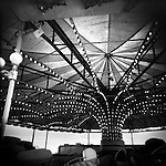 Monochrome Holga carnival image of ceiling and lights on a ride