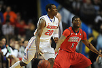 Florida's Michael Frazier II (20) vs. Ole Miss' Martavious Newby (1) in the SEC championship game at Bridgestone Arena in Nashville, Tenn. on Sunday, March 17, 2013.