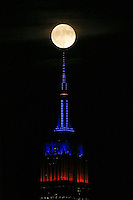 HOBOKEN, NJ - OCTOBER 16: A full Hunter's super moon rises behind the Empire State Building in New York City on October 16, 2016 as seen from Hoboken, NJ, VIEWPRESS/Kena Betancur