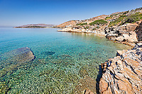 Rocky shore of St. Kyprianos in Andros, Greece