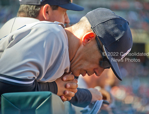 New York Yankees manager Joe Girardi (28) seems to be praying during his team's ninth inning rally against the Baltimore Orioles at Oriole Park at Camden Yards in Baltimore, MD on Sunday, April 9, 2017.  The Yankees won the game 7 - 3. <br /> Credit: Ron Sachs / CNP<br /> (RESTRICTION: NO New York or New Jersey Newspapers or newspapers within a 75 mile radius of New York City)