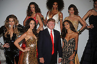 Donald Trump, with Miss USA 2004 Shandi Finnessey, (L) Miss Universe 2003 Amelia Vega and (R) Miss Universe 2008 Dayanna Mendoza attend a Miss Universe photocall at Chelsea Piers, Studio 59 on July 27, 2011 in New York City. Credit: Dennis Van Tine/MediaPunch