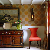 The Arts and Crafts-style dining room is covered with William Yeoward's 'Hortense Gold' fabric