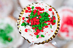 Christmas cupcakes with colorful sprinkle decorations on top for the Holiday Season