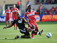 DC United defender Julius James (2) slide tackles the ball away from Chicago Fire forward Patrick Nyarko (14).  The Chicago Fire tied DC United 0-0 at Toyota Park in Bridgeview, IL on Oct. 16, 2010.