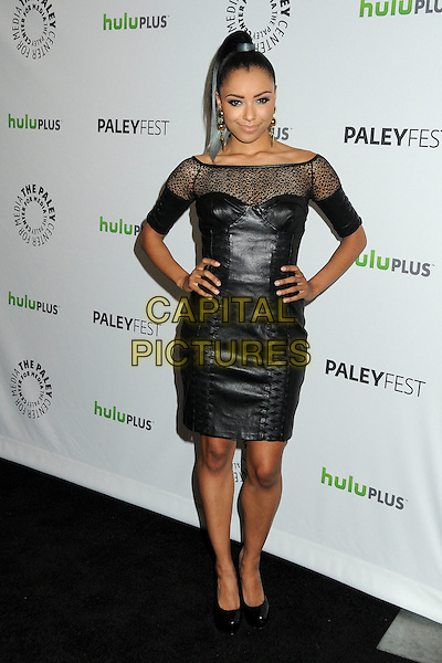 """Kat Graham.PaleyFest 2012 Presents """"The Vampire Diaries"""" held at the Saban Theatre. Beverly Hills, California, USA, .10th March 2012.full length off the shoulder sheer leather dress  black  corset bustier hands on hips .CAP/ADM/BP.©Byron Purvis/AdMedia/Capital Pictures."""