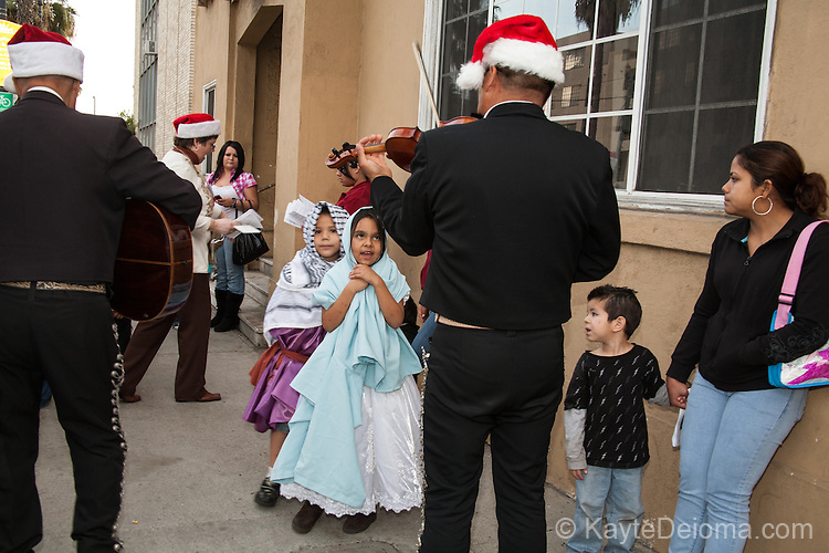 Mexican community members participating in the Christmas tradition of Las Posadas in Long Beach, CA