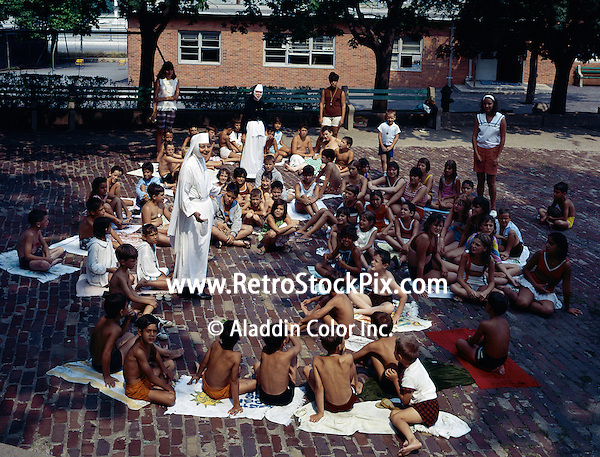 St. John Villa Academy, New York. A nun speaking to young children after a swim.
