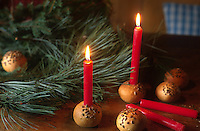 Delicate seeded rolls are used as candle holders for Christmas decoration