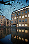 Victorian building in north London converted to office space with reflections in the canal