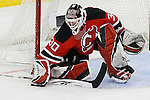 Mar 17, 2009; Newark, NJ, USA; New Jersey Devils goalie Martin Brodeur (30) makes a save during the second period of their game against the Chicago Blackhawks at the Prudential Center.