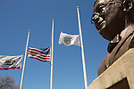 Flags wave half staff at town plaza to honor the victims of the April 15 Boston Marathon Bombings.